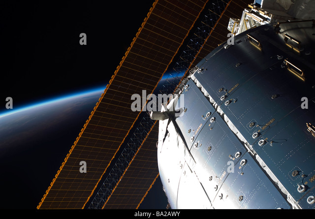 A portion of the International Space Station's Columbus laboratory and solar array panels. - Stock-Bilder