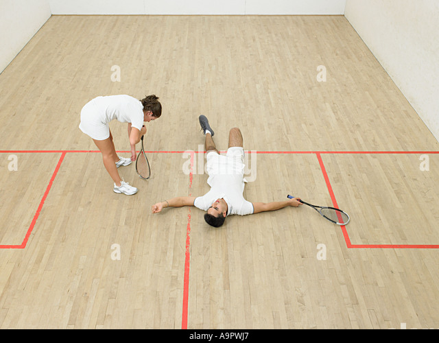 Exhausted squash players - Stock Image