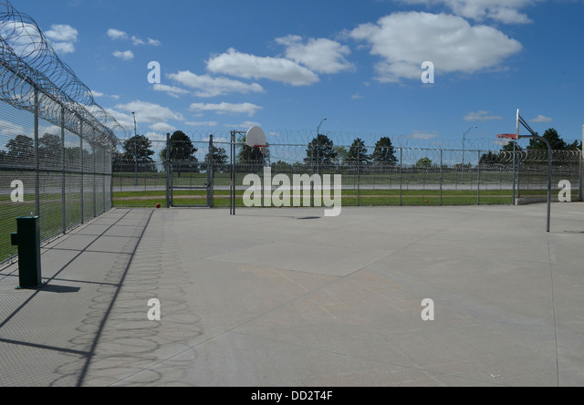 Fenced yard at American maximum security prison. Here inmates are allowed outside to walk, exercise, and socialize. - Stock Image