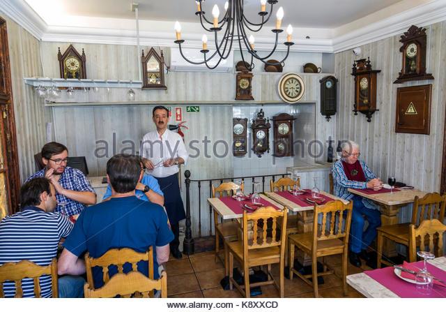 Portugal Lisbon Bairro Alto historic district Tascardoso neighborhood restaurant cafe Hispanic man table waiter - Stock Image