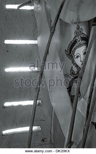 Detail of a Buddhist prayer flag depicting an apsara, Nong Beau Dang, Chiayaphum province, Isan, North East Thailand. - Stock Image