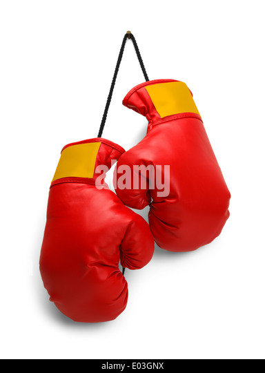 Pair of Red Boxing Gloves Hanging Isolated on White Background. - Stock Image