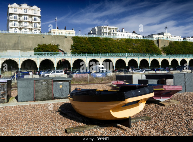 Boats on beach at Brighton, Sussex, UK - Stock Image