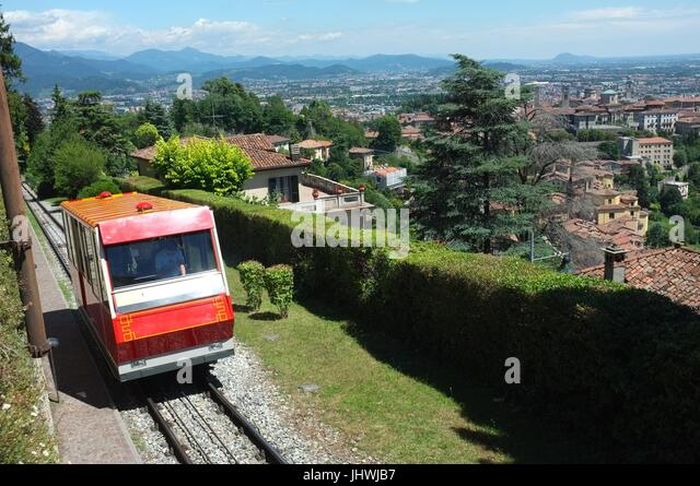 The funicular railway train approaching Saint Vigilio, Citta Alta (upper city), Bergamo, Lombardy, northern Italy, - Stock Image