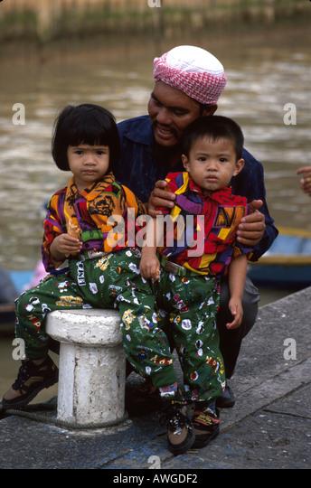 Brunei Bandar father boy girl Muslims near Temu Open Air Market - Stock Image