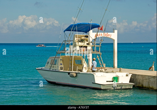 Cozumel Mexico San Miguel town deep sea fishing boat open space text space copy space type space - Stock Image