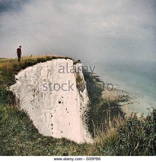 Looking over the cliff - Stock Image