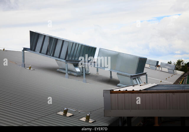 Air handling units on industrial building roof - Stock Image