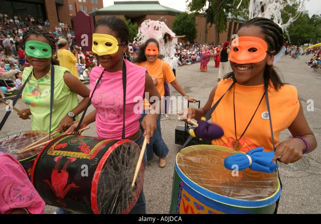 Cleveland Ohio University Circle Parade the Circle Arts Cultural Festival Black teens masks drums - Stock Image