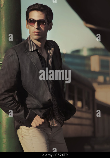 Fashion style photo of an elegant young man - Stock Image