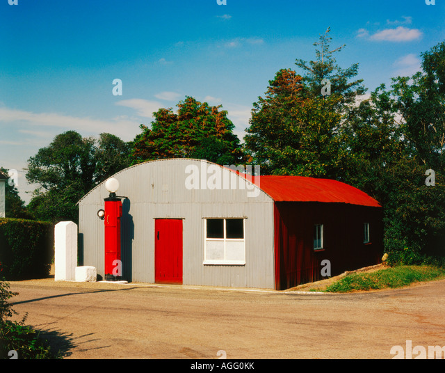 an old petrol service garage with  petrol pump  in a rural Irish setting - Stock Image