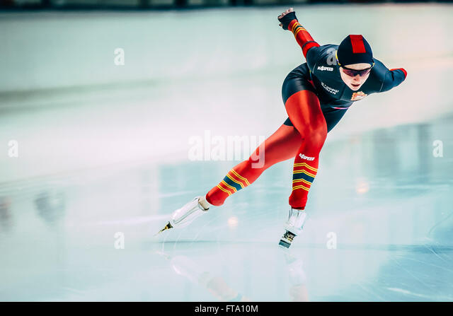 Chelyabinsk, Russia - October 15, 2015: female athlete speed skaters track runs during Cup of Russia on speed skating - Stock Image