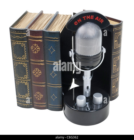 Story broadcasts shown by a retro pill audio microphone with an on the air banner inside a set of books - path included - Stock Image