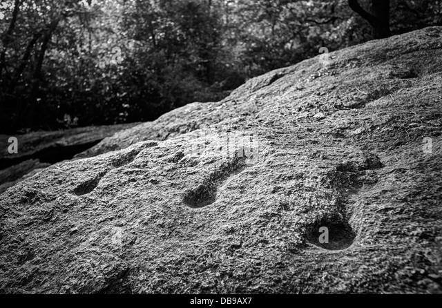 Prehistoric art. Cups on rock - Stock Image