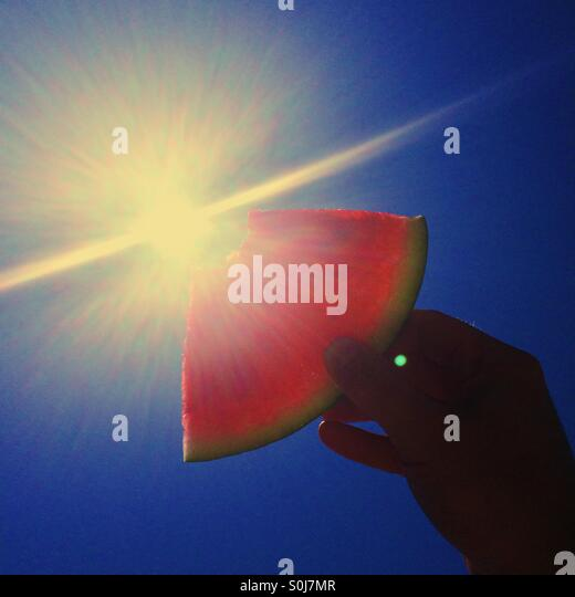 Watermelon held up to the sun - Stock Image