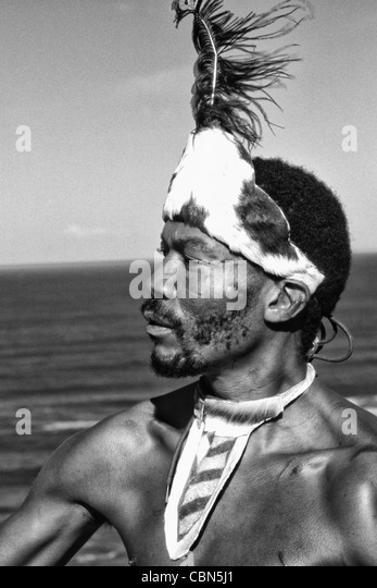 Native Pondo Tribe Warrior in South Africa on the Water Near Wilderness - Stock Image