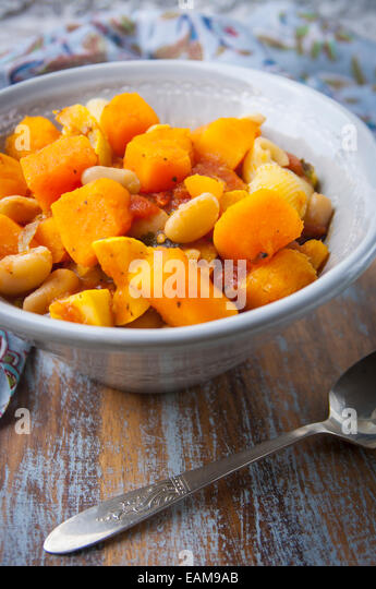 A Close Up View of a Bowl of Vegan Butternut Squash Stew - Stock Image