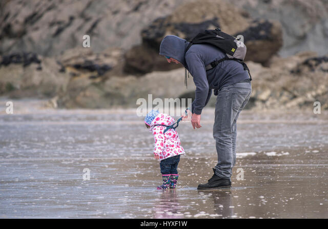 Father Daughter Child Toddler Parenting Family activity Sea Seaside Learning New experience Parenting Care Caring - Stock Image