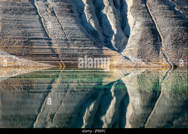 Nature abstract painting created from mountain slopes on  water in a lake - Stock Image
