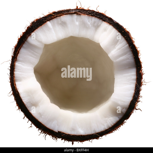 Half of the coconut is isolated on a white background. File contains a clipping paths. - Stock Image