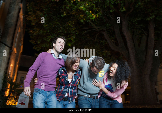 young people out at night in town - Stock Image
