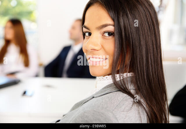 Portrait of beautiful smiling businesswoman - Stock Image