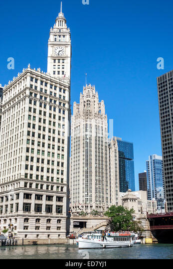 Illinois Chicago Chicago River downtown Wrigley Building city skyline skyscrapers Riverwalk boat - Stock Image