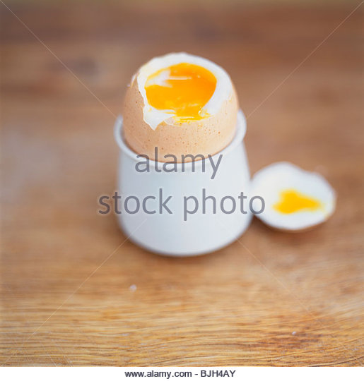 Soft-boiled egg in eggcup - Stock Image