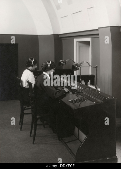 Two female operators at a Western Electric switchboard, Landskrona, Sweden, 1927. From the Landskrona Museum Collection. - Stock Image