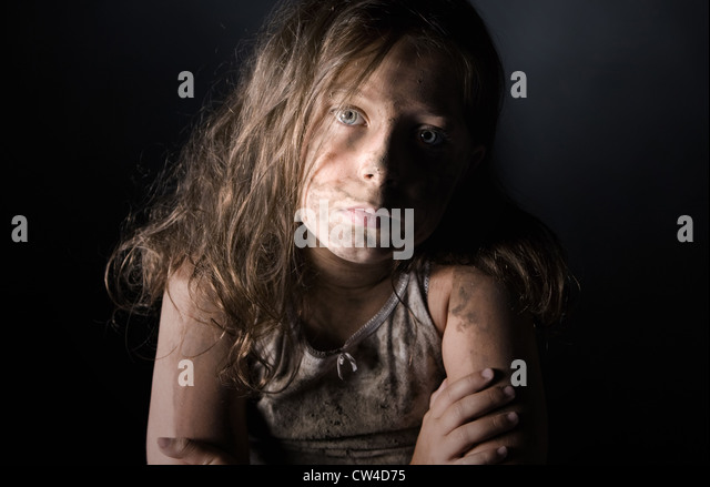 Low Key Shot of a Filthy Child - Stock Image