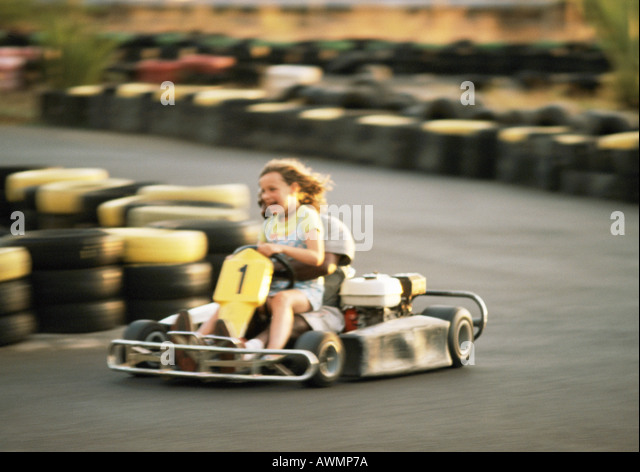 Two people go-carting, blurred motion - Stock-Bilder