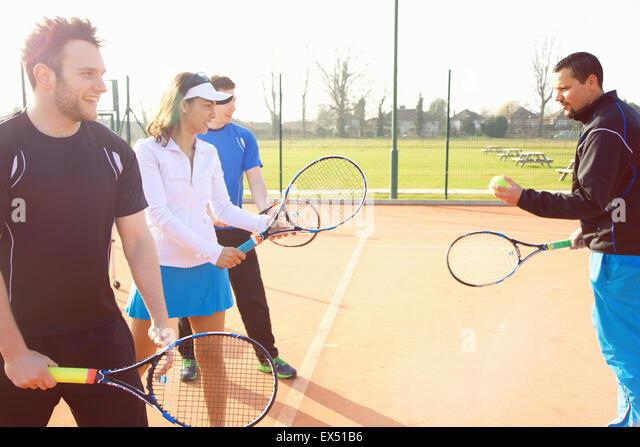 Tennis Instructor Teaching Class - Stock Image