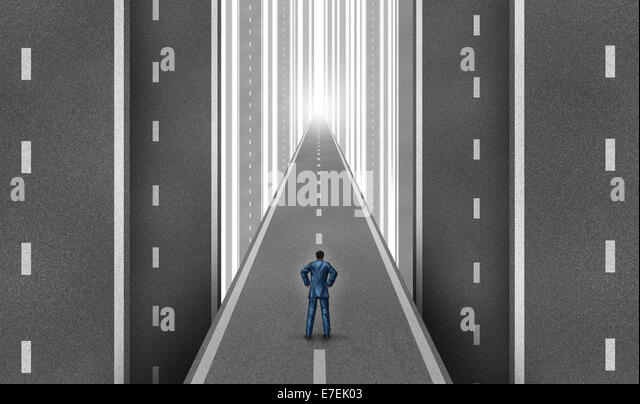 Businessman road concept as a group of vertical highways with a man standing on a straight path to success as a - Stock Image