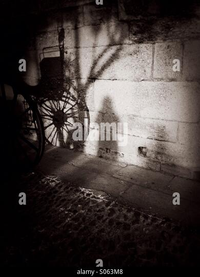 Shadow of horse carriage - Stock Image