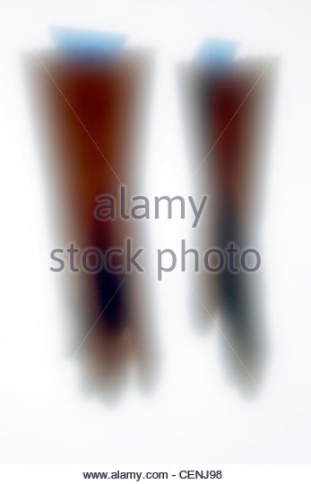 outline of household working gloves with blue tape - Stock Image