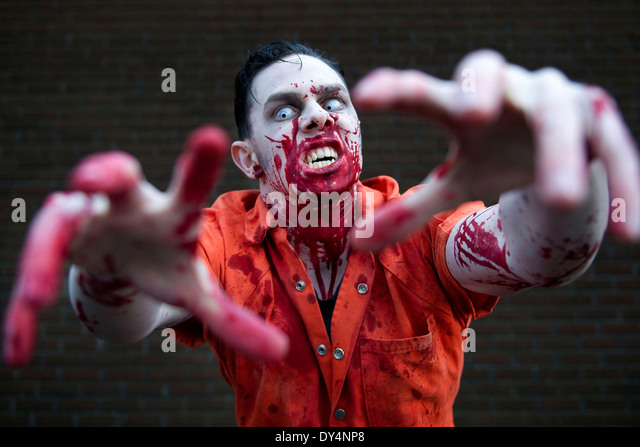 A frightening zombie covered in blood - Stock Image