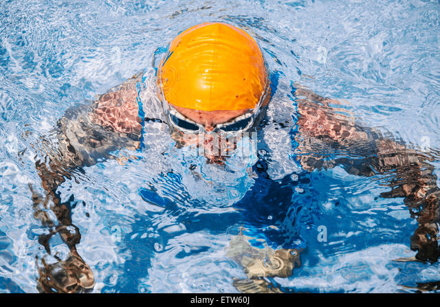 Spain, Mallorca, Sa Coma, triathlet  swimmer coming up out of the water - Stock-Bilder