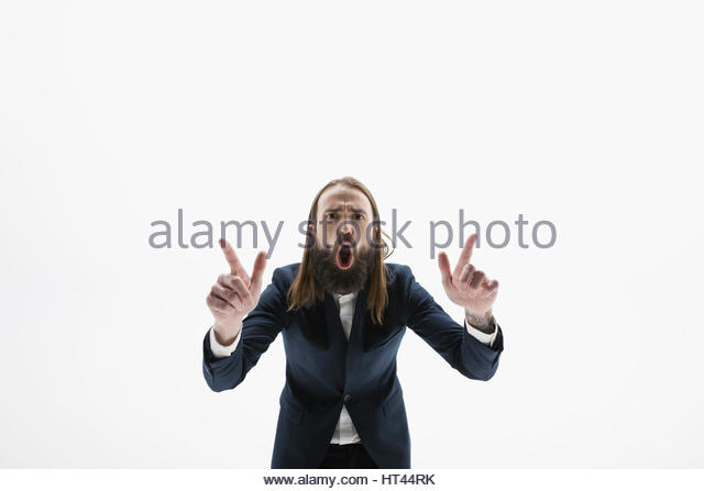 Portrait exuberant businessman with beard gesturing and yelling against white background - Stock-Bilder