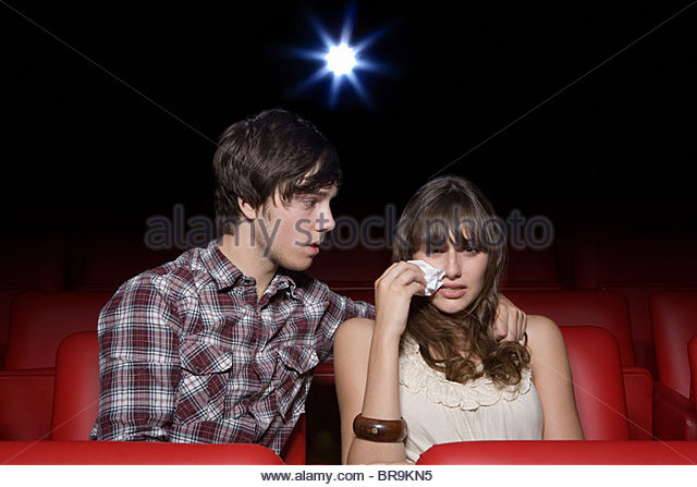 Young couple in the movie theater, both crying - Stock-Bilder