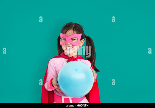 Superhero Girl Child Kid Inspiration Concept - Stock Image