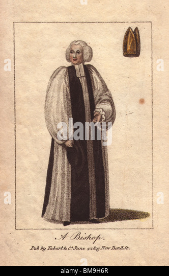 A Bishop. In long black and white robes, wearing a white wig. A gold mitre at top right. - Stock Image