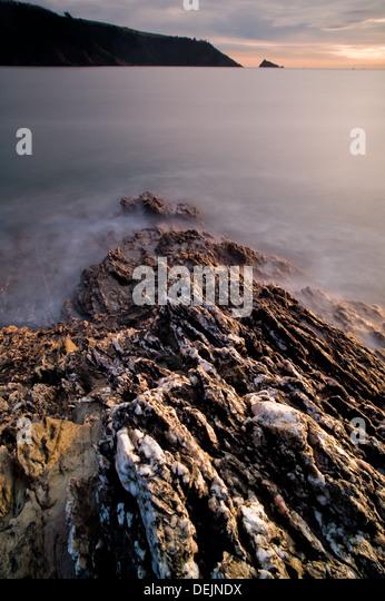 Rocks leading into Deadmans Cove Dartmouth Devon England - Stock-Bilder