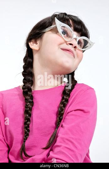 Girl wearing retro glasses - Stock Image