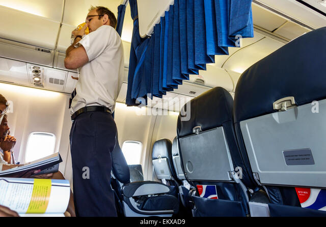 Johannesburg South Africa African O. R. Tambo International Airport inside BA British Airways commercial airliner - Stock Image