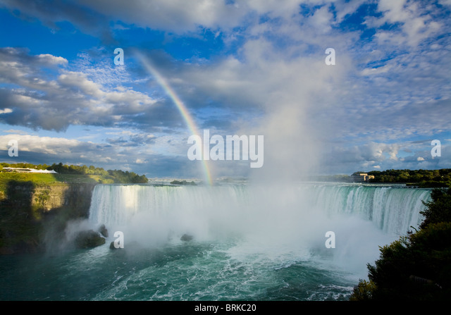 Rainbow and spectacular clouds over Horseshoe Falls, Niagara Falls, Ontario, Canada - Stock-Bilder