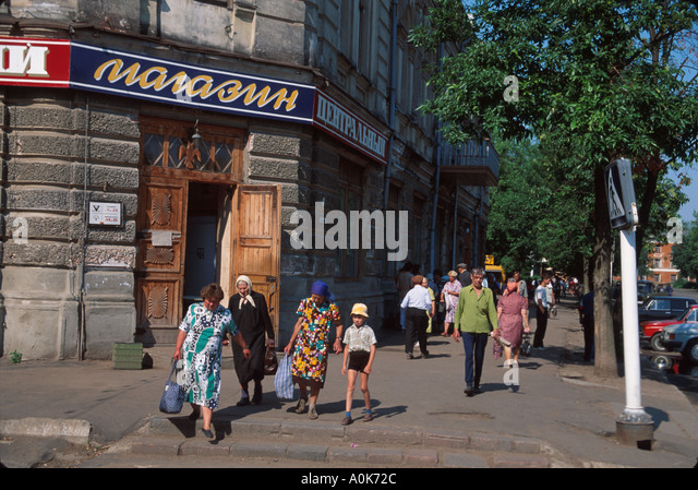 Russia former Soviet Union Uglich residents businesses city street corner - Stock Image