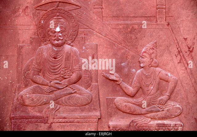 Bhagavad Gita engraved on a Hindu temple : dialogue between Krishna and Arjuna - Stock Image