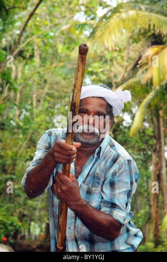 an-indian-man-punting-through-the-kerala