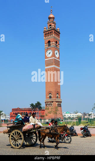 A horse cart passing by the Husainabad Clock Tower in Lucknow. - Stock Image