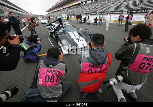 1969 Lola T70 MKIII B (owned by Le Mans Classic Japan sponsor Richard Mille) on pole position of the starting grid. - Stock Image